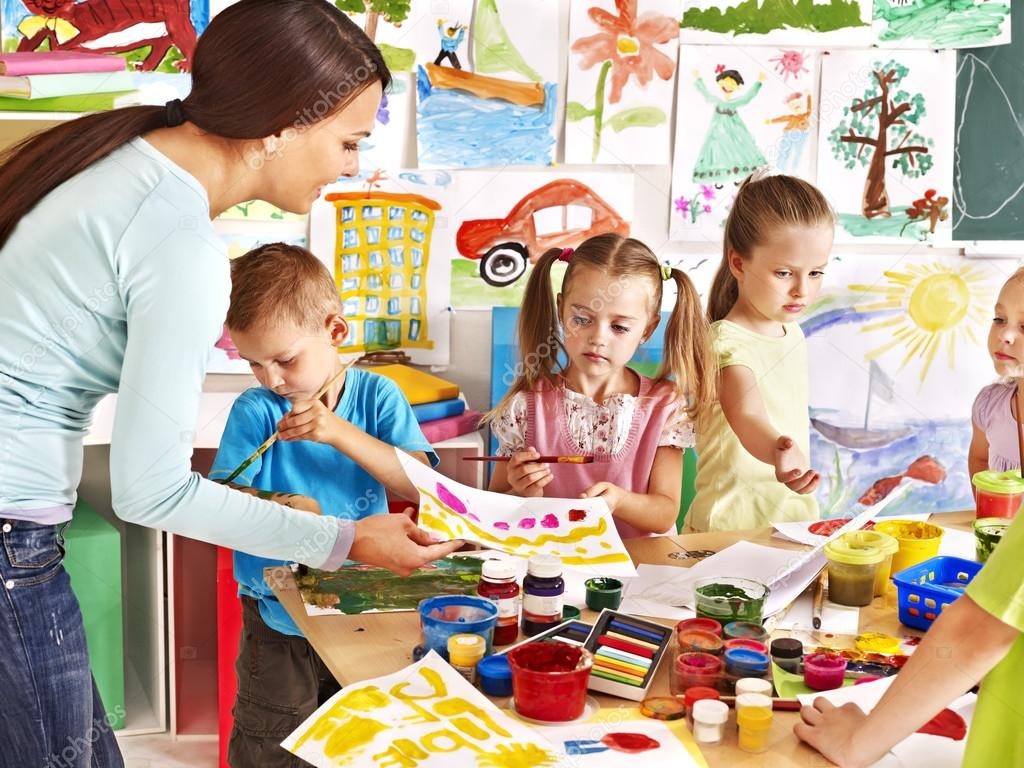depositphotos_29032159-stock-photo-children-with-teacher-at-school
